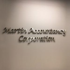 Martin Accountancy Corporation firm name on the wall